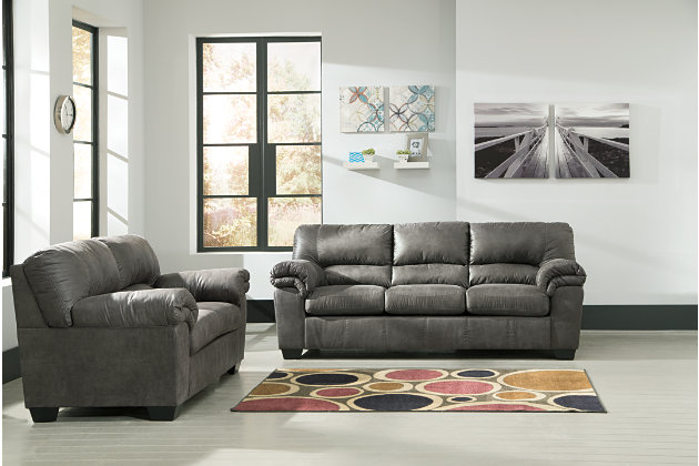 This living room features a sofa and love seat in an elegant slate colored palette