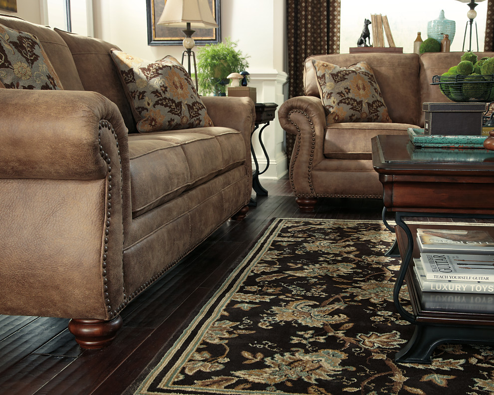 Rolled Arms And Nailhead Trim Give This Sofa And Loveseat A Classic  Traditional Look