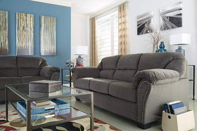 Nailhead Trim Accents the Curved Frame of this Charcoal Gray Couch Set