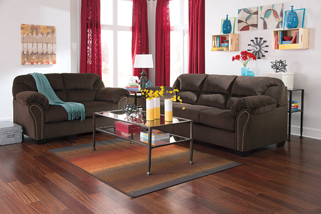 Appealing Curved Frame and Wedge Feet on this Contemporary Dark Brown Sofa and Love Seat