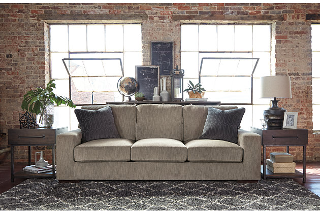 Contemporary Entwine Sofa and Industrial Look End Tables Compliment each other in this Living Room Set
