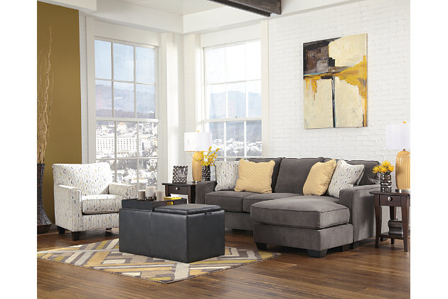 soft grey chaise lounge sofa accented by storage ottoman and accent chair