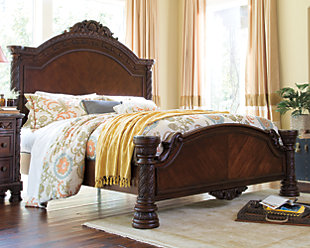 Rich Brown Finish Over Ornate Detailed Appliques On This King Bed