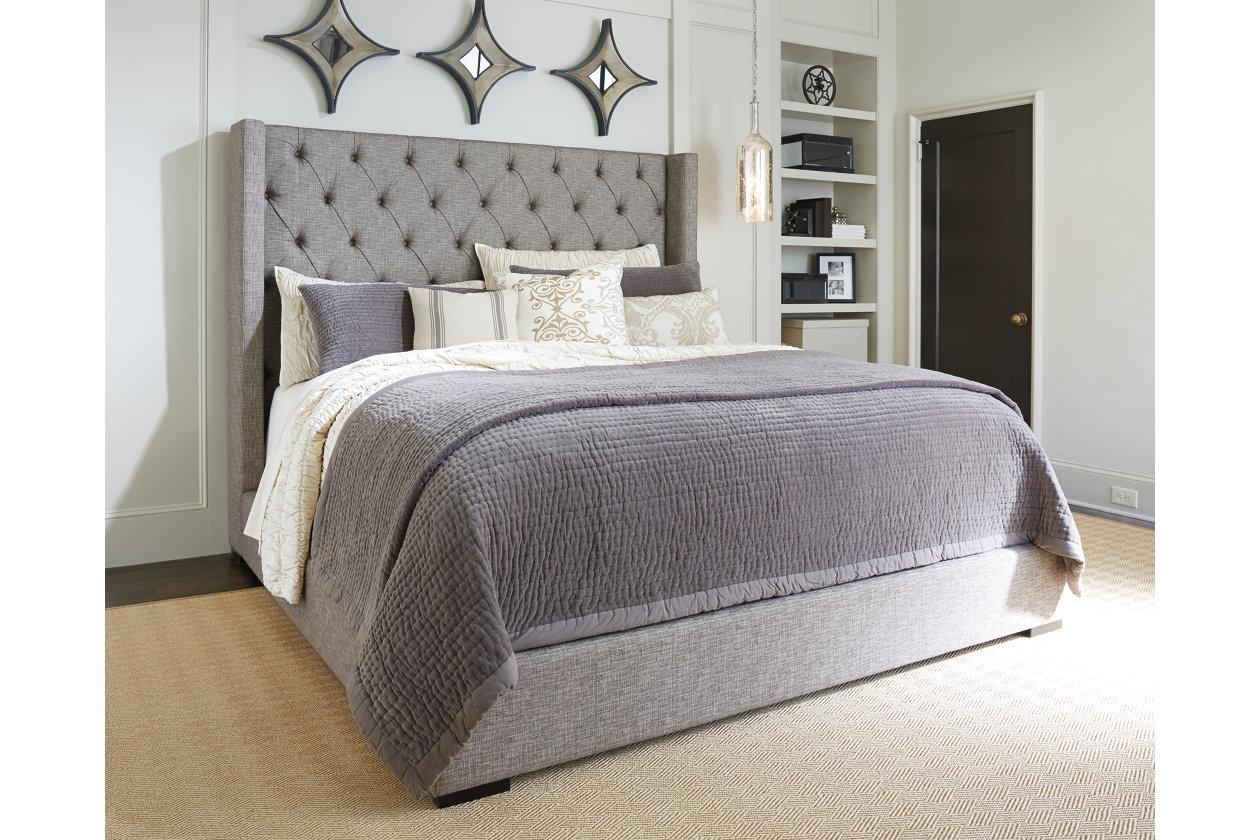 light grey upholstered bed