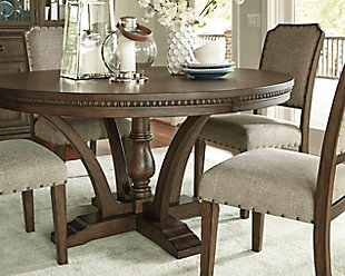 Four Sweeping Braces Adorn This Dark Brown Pedestal Table