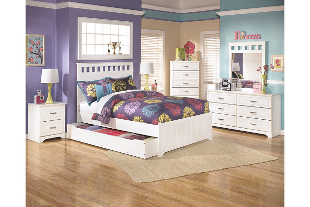 white trundle bed has a white full headboard with square cut outs accompanied by white chest