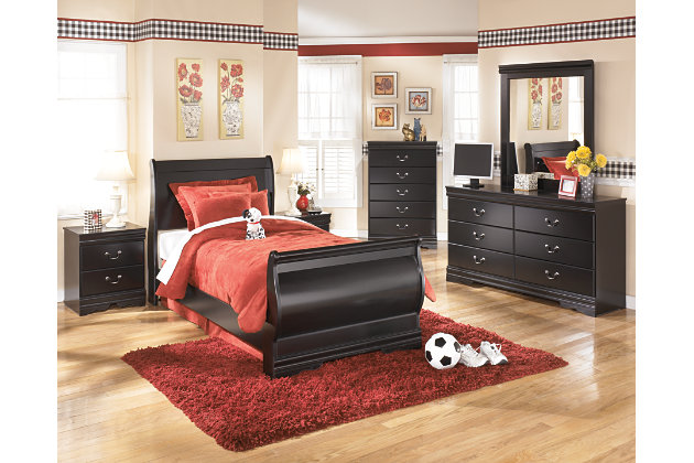 black twin sleigh bed with dark wood bedroom furniture