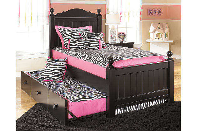 twin poster bed with vintage style headboard and footboard and attached twin trundle bed