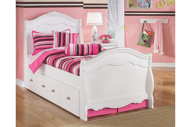 beautiful white twin bed and trundle bed adorned with appliques and rosettes with plenty of curve
