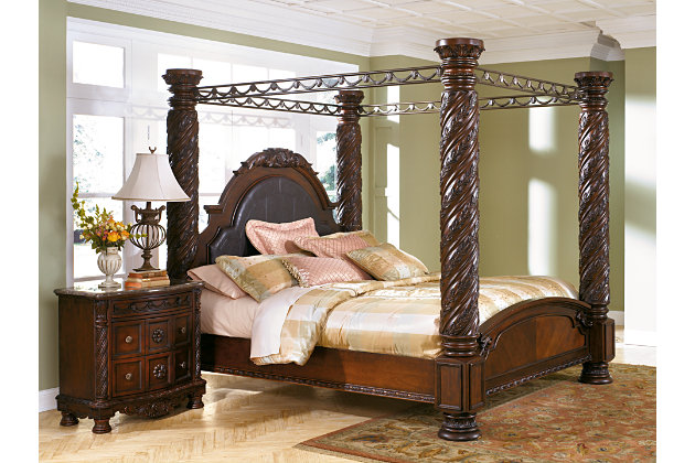 large decorative pillars and canopy make a grand stance on this king bed. North Shore   Ashley Furniture HomeStore