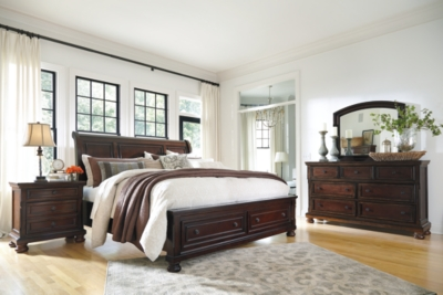 Picture of: Porter Queen Sleigh Bed With Mirrored Dresser And Chest Ashley Furniture Homestore