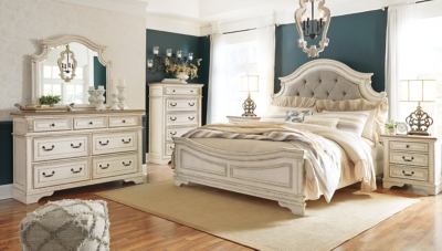 Picture of: Realyn Queen Upholstered Panel Bed With Dresser Ashley Furniture Homestore