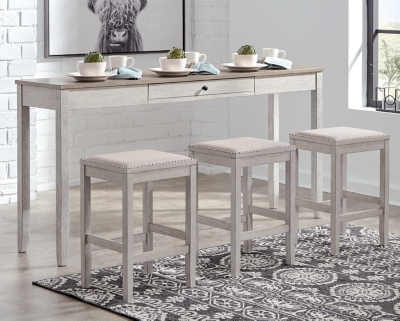 Picture of: Skempton Counter Height Dining Table And Bar Stools Set Of 3 Ashley Furniture Homestore