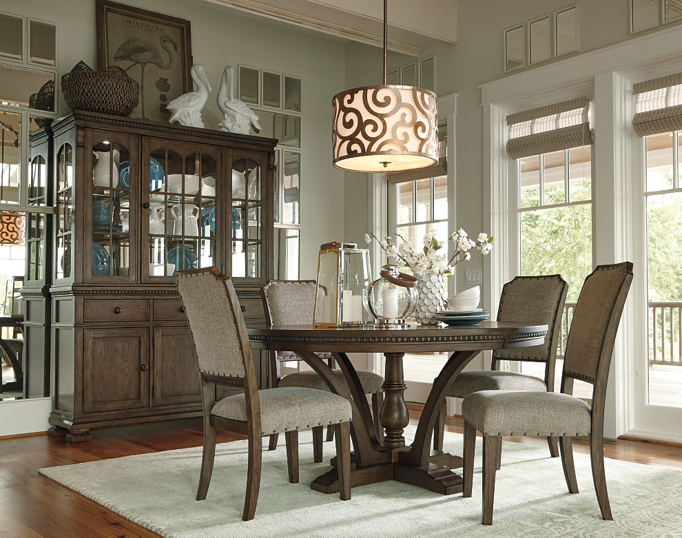 Gray Brown Finished Pedestal Dining Table And Upholstered Room Chairs Paired With A Beautiful China