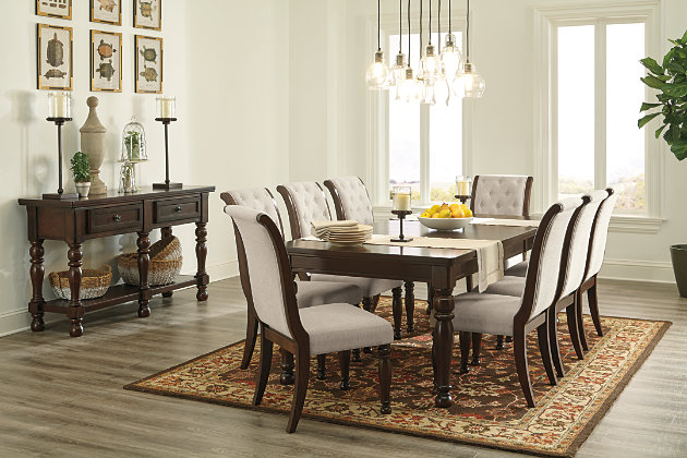 Cherry Brown Finished Dining Room Tables Paired With Upholstered Chairs And Buffet