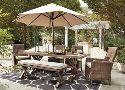 Beachcroft Outdoor Dining Table With Umbrella Option Ashley Furniture Homestore
