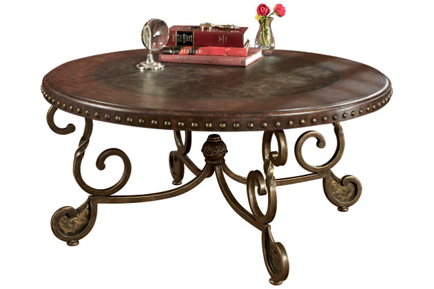 Dark Stained Wood Round Cocktail Table With A Nailhead Trim Will Enhance  Your Living Room