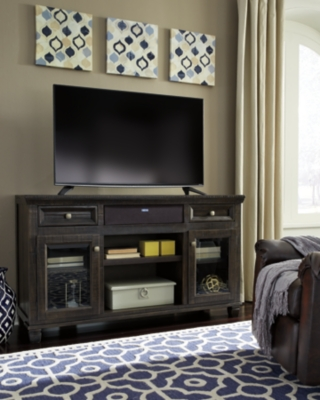 """Ashley Townser 62"""" TV Stand with Wireless Pairing Speaker..."""